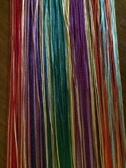 """Birthstones"" EveryDay Rainbow features golden strands between light and dark birthstone colors"